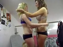 Awkwardly kissing her friend and taking off her top