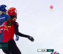 Chinese skater couldn't resist with Elise Christie in front of her.