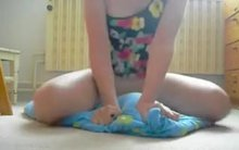Horny woman humping a pillow