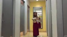 Natalie Austin flashing in changing room hallway