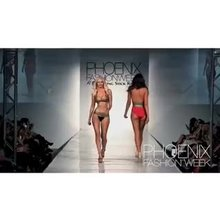 Zienna Eve modelling bikinis on the catwalk