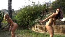 Sheena Shaw and Mischa Brooks having a milk fight