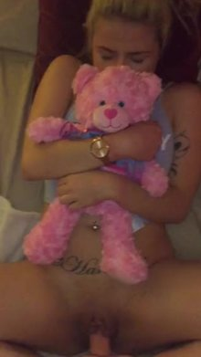 holding her teddy bear close by while she takes a thick cock