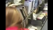 Guy fucks a woman doggy style in a library and busts a load inside of a library book
