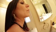 Kendra Lust giving an oily assjob