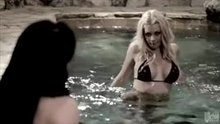 Riley Steele and Aiden Ashley fooling around in the pool