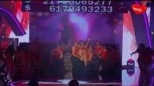 Antonella removing her bra on stage