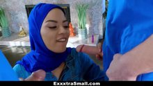 Woman in hijab sucks two cocks